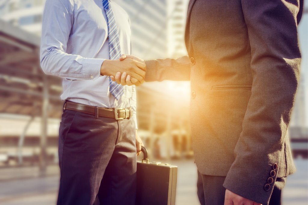 success-and-happiness-concept-businessman-handshake-at-city-outside-picture-id638615786